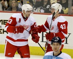 Pavel Datsyuk and Darren Helm of the Detroit Red Wings,