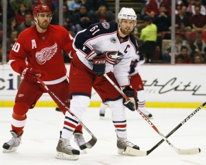 DETROIT, MI - MARCH 7:  Rick Nash #61 of the Columbus Blue Jackets skates in front of Henrik Zetterberg #40 of the Detroit Red Wings in a game on March 7, 2009 at the Joe Louis Arena in Detroit, Michigan. (Photo by Claus Andersen/Getty Images)