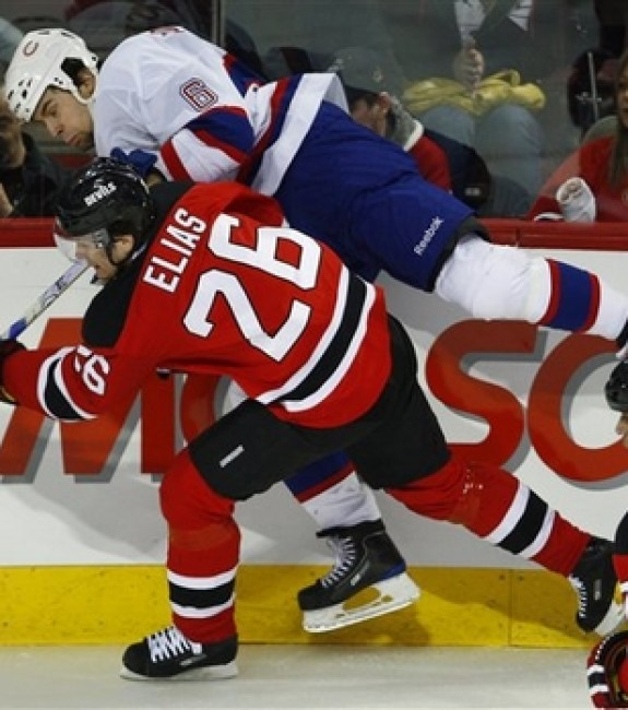 Patrik Elias throws a hit against a future teammate, Tom Kostopoulos. (AP photo/The Canadian Press,Paul Chiasson)