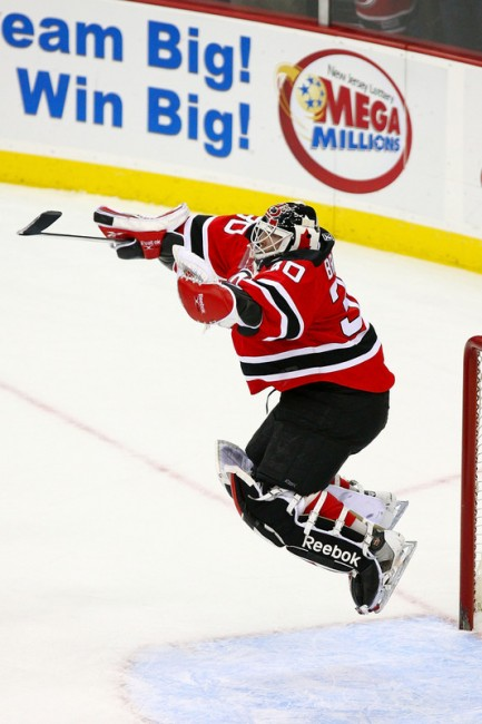 Martin Brodeur jumps up for joy after setting the all-time wins record in 2009. (File Photo)