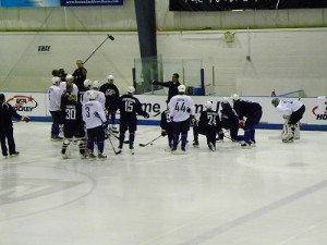 """Torts"" goes over a play at practice (image property of the author)"