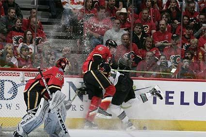 Calgary defenseman Dion Phaneuf hits Patrick Marleau of the San Jose Sharks in a dangerous way during a meeting in the 2007-08 season. (Image Credits: sharkspage)