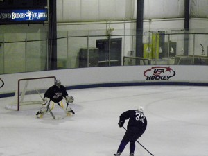 Ryan Miller takes on Dustin Byfuglien at Olympic Camp. (photo property of author)