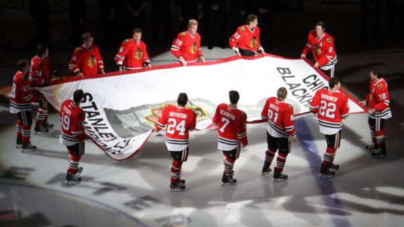 Blackhawks skate their Stanley Cup banner across United Center ice