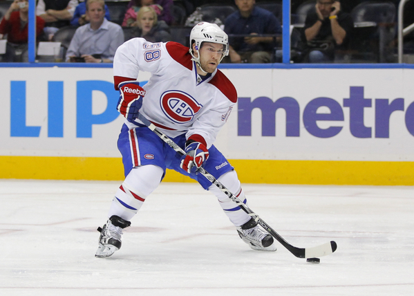David Desharnais takes the puck on the offensive for the Montreal Canadiens.