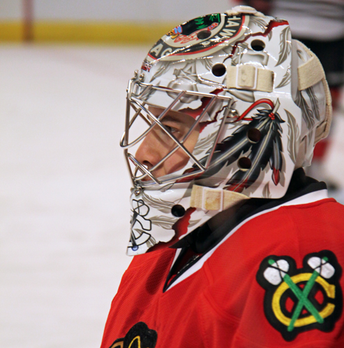 Blackhawks goaltender Corey Crawford looks on during a game last season