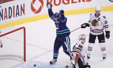 Blackhawks Down ; Canucks Win Opener 2-0