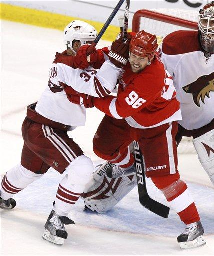 Coyotes Adrian Aucoin takes on Red Wings Tomas Holmstrom in the 2010 NHL Playoffs (AP Phote/Carlos Osorio)