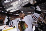 Marian Hossa, a key player that Dale Tallon signed in 2009, skating with Stanley Cup in 2010. (AP Photo/Matt Slocum)