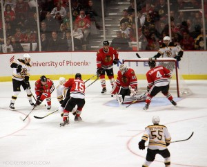 Corey Crawford makes a stop against the Bruins, 10/15/11 - photo by Cheryl Adams