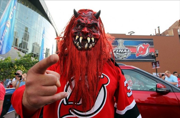 Not all Devils fans dress like this guy, but they are all passionate. (Ed Mulholland-US PRESSWIRE)