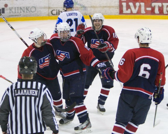 Team USA coming together to celebrate a goal against Team Finland in the bronze medal game. (Photo Courtesy of Maureen Lingle)