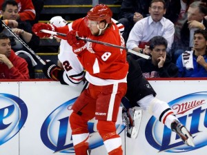 Justin Abdelkader checks Chicago Blackhawks defenseman Michal Rozsival