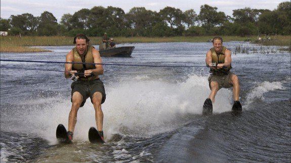 Hockey brothers Bates (left) and Anthony (right) water ski in crocodile infested waters. (CBS ©2013 CBS Broadcasting, Inc. All Rights Reserved.)