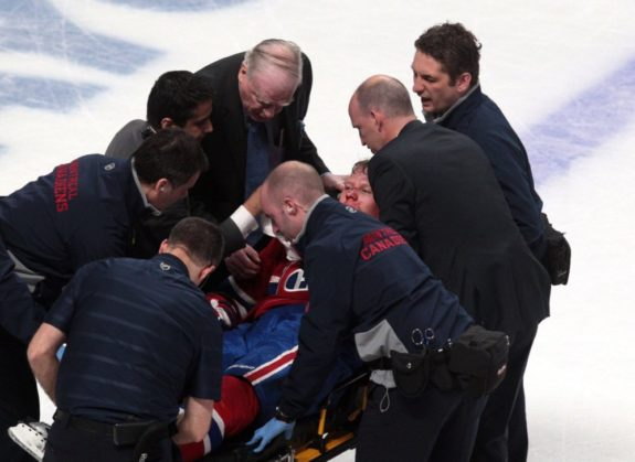 Lars Eller being carted off the ice last night at The Bell Centre. (Jean-Yves Ahern-USA TODAY Sports)