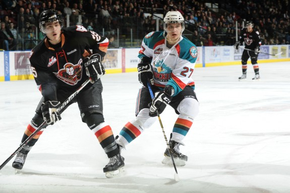 Greg Chase, left, of the Calgary Hitmen. (Shoot the Breeze Photography)