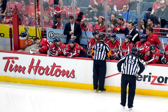 Referee Eric Furlatt addresses the Capitals' bench (Flickr/Clydeorama)