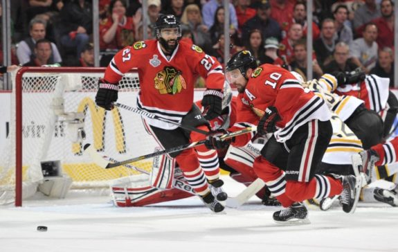 Johnny Oduya defends during the 2013 Stanley Cup Finals. (Rob Grabowski-USA TODAY Sports)