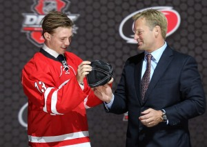 Elias Lindholm receives his team cap after being drafted 5th overall (Ed Mulholland-USA TODAY Sports)