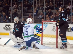 Nov 7, 2013; San Jose, CA, USA; Vancouver Canucks center Brad Richardson (15) scores against San Jose Sharks goalie Antti Niemi (31) during the first period at SAP Center at San Jose. Mandatory Credit: Ed Szczepanski-USA TODAY Sports