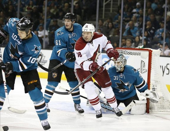 Nov 2, 2013; San Jose, CA, USA; Phoenix Coyotes left wing David Moss (18) and San Jose Sharks defenseman Justin Braun (61) in front of San Jose Sharks goalie Antti Niemi (31) during the third period at SAP Center at San Jose. Phoenix Coyotes won 3-2. Mandatory Credit: Bob Stanton-USA TODAY Sports