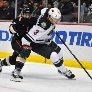 Charlie Coyle powers his way around an Anaheim defender.