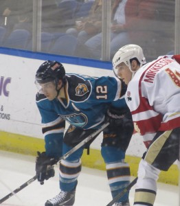 Defenseman Brendan Mikkelson takes a faceoff in a December matchup against the Worcester Sharks. (Alison Myers/THW)