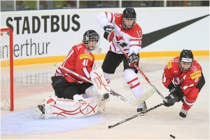 Gillian Apps (#10 CAN), Florence Schelling (#41 SUI), and Julia Marty (#6 SUI), 2011 IIHF World Championships (_becaro_/Flickr)