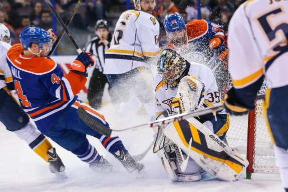 (Sergei Belski-USA TODAY Sports) Nashville Predators goaltender Pekka Rinne, seen here making a save on Taylor Hall of the Edmonton Oilers last March, has been arguably the NHL's top netminder through 20 games this season after being limited to just 24 games (and below-average statistics) all of last season.
