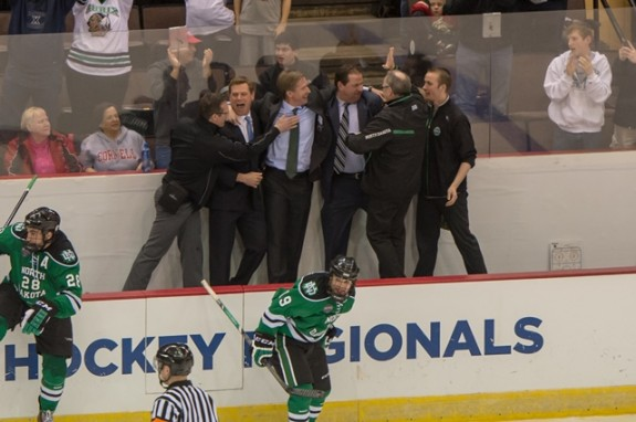 The UND coaching staff celebrates the Midwest Regional Win (Eric Classen /UND Athletics)