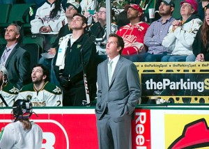 Modano watches highlights prior to dropping the puck (Ross Bonander/THW)