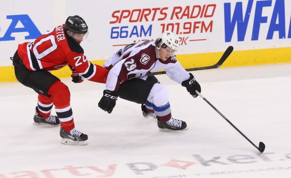 Ryan Carter works against Nathan McKinnon of the Colorado Avalanche. (Ed Mulholland-USA TODAY Sports)