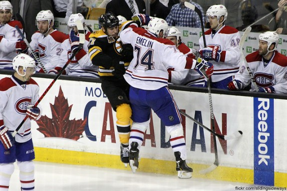 Milan Lucic checks Alexei Emelin (slidingsideways/Flickr)