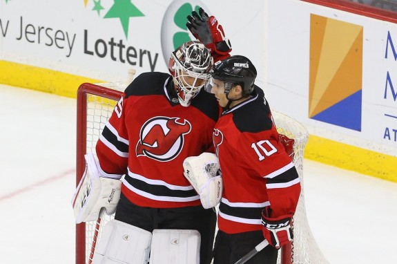 Cory Schneider hopes to celebrate a few more wins this season. (Ed Mulholland-USA TODAY Sports)