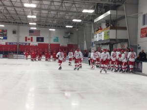 The teams take the ice to start the annual prospect scrimmage game. (Photo: Zackary Landers)