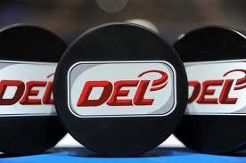 DEL logo on three pucks
