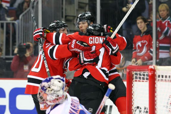 Steve Bernier (center) celebrates a goal with his CBGB linemates. (Ed Mulholland-USA TODAY Sports)