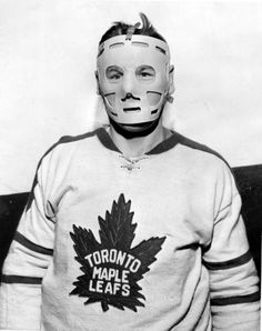 A rare photo of Johnny Bower wearing a mask.
