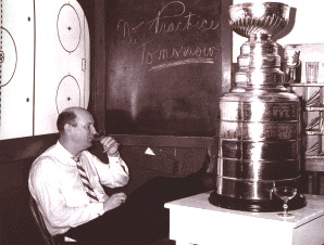 Punch Imlach, in happier times, will guide the Leafs for four more years.