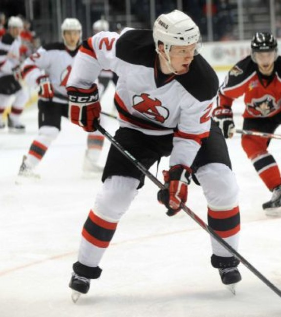 Seth Helgeson controls the puck during Albany's game against the Portland Pirates in 2013, at Times Union Center in Albany, N.Y. (Cindy Schultz / Times Union)