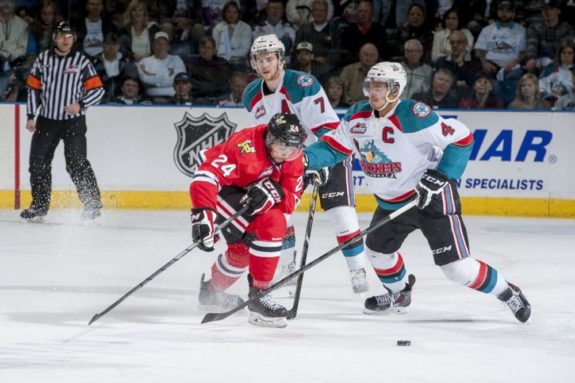(Marissa Baecker/www.shootthebreeze.ca) Kelowna Rockets captain Madison Bowey, right, pokes the puck away from former Portland Winterhawks defenceman Mathew Dumba during the Western Conference final this past spring at Prospera Place in Kelowna. The Winterhawks won the third-round playoff series in five games before losing to the eventual Memorial Cup champion Edmonton Oil Kings in the WHL final. At left is former Rockets defenceman Damon Severson, who, like Dumba, is now starring in the NHL with the New Jersey Devils and Minnesota Wild, respectively, while Bowey is back in Kelowna as one of the WHL's premier blue-liners.