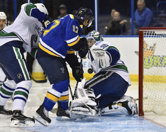 Oct 23, 2014; St. Louis, MO, USA; Vancouver Canucks goalie Ryan Miller (30) blocks the shot of St. Louis Blues left wing Jaden Schwartz (17) during the second period at Scottrade Center.  (Jasen Vinlove-USA TODAY Sports)