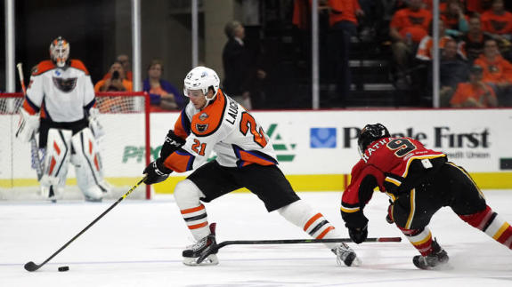 Phantoms Center Scott Laughton (21) steals the puck from Flames Forward Garnet Hathaway (9) during second period action Friday at the PPL Center in Allentown. [photo: Chris Knight]
