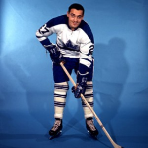 Frank Mahovlich tackled team mate Douglas.