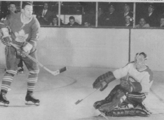 Frank Mahovlich is stopped by Charlie Hodge