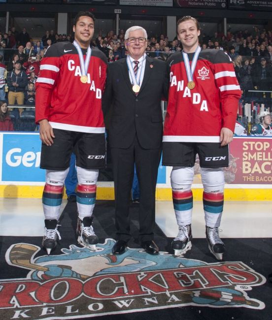 (Marissa Baecker/www.shootthebreeze.ca) Madison Bowey, left, and Josh Morrissey, right, pose with Kelowna Rockets general manager Bruce Hamilton upon returning to the WHL club with gold medals from the world juniors.