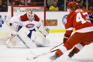 Montreal Canadiens goaltender Dustin Tokarski and Detroit Red Wings forward Darren Helm
