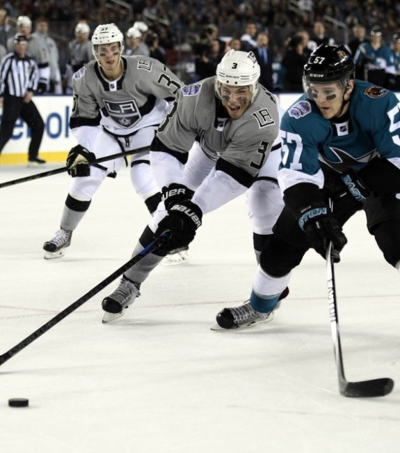 Brayden McNabb and Tommy Wingels skate for the puck in the Stadium Series (Kyle Terada-USA TODAY Sports)