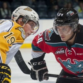 (Marissa Baecker/www.shootthebreeze.ca)Nolan Patrick of the Brandon Wheat Kings, left, faces off against Tyson Baillie of the Kelowna Rockets during WHL regular-season action in Kelowna on Oct. 25. The Rockets won 6-1 in the only meeting to date between the two teams, but the Wheat Kings will host Game 1 of the WHL championship series in Brandon tonight.