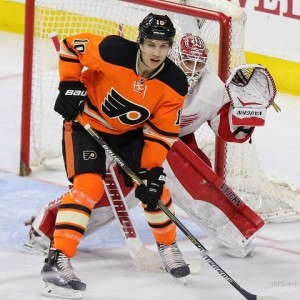 Brayden Schenn screening Jimmy Howard of the Detroit Red Wings.